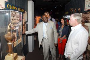 Bob Kendrick (center) giving Baltimore Orioles manager Buck Showalter (right) a tour of the Negro League Baseball Museum.